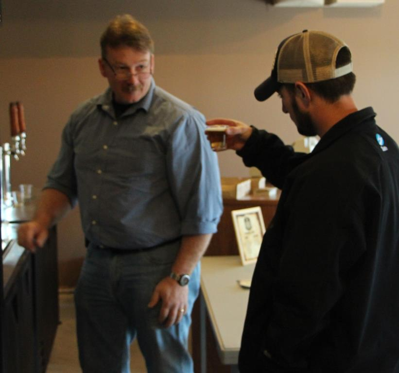 John Picard sampling beer at the Brewery Farm